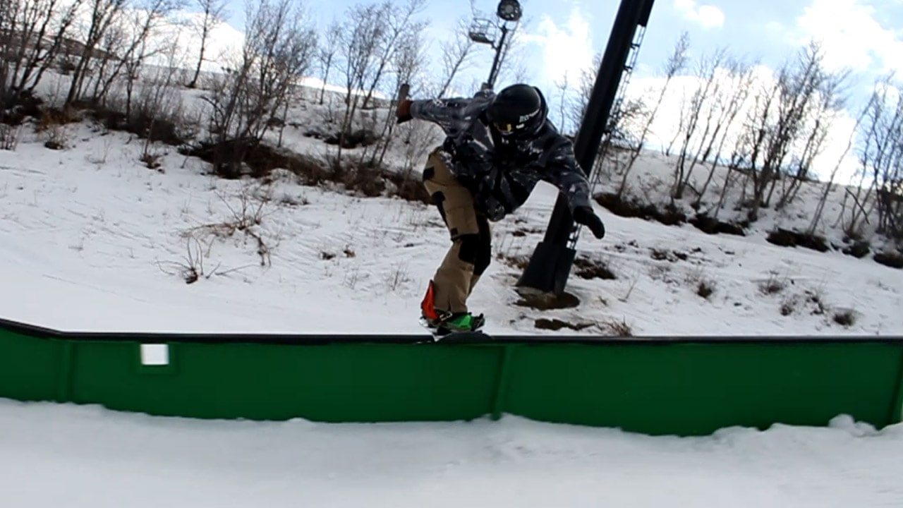 Frontside Boardslide on a Snowboard